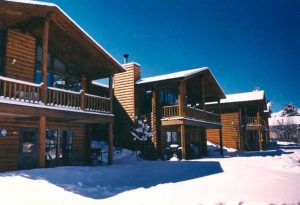 Log sided lodge in the snow in Estes Park