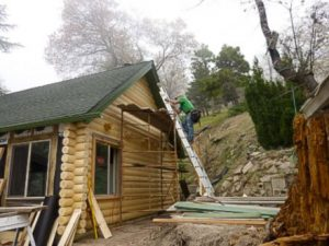 Remodel with log siding and Timberline log corners on house in California