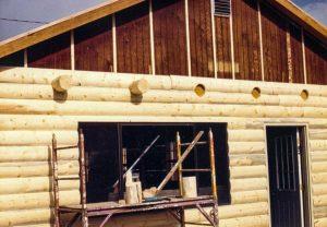 Log rafter tails on log siding