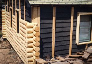 Remodel with log siding and Timberline log corners In Hygiene CO