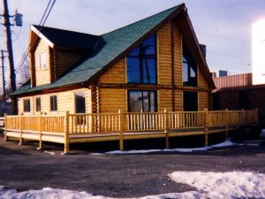 Modular home with log siding and prow front.