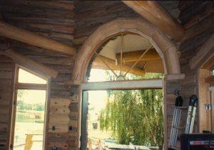 Interior beetle kill wood. arched log trim window