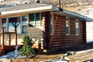 Remodel with log siding and Timberline log corners in the mountains above Lyons, CO