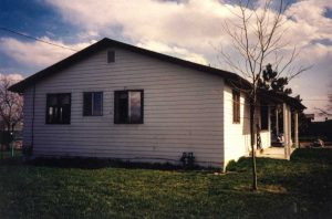 Remodel with log siding and Timberline log corners on house with lap siding.