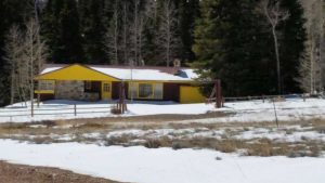 Remodel with log siding and Timberline log corners on ugly house in Wyoming.