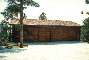 Remodel with log siding and Timberline log corners on a garage to match the owners log house.
