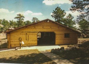 Remodel with log siding and Timberline log corners on horse barn.