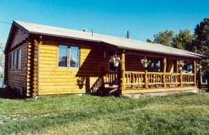 Remodel with log siding and Timberline log corners on house with lap siding. Beautiful log orch