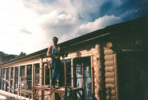 Remodel with log siding and Timberline log corners on a earth-home.