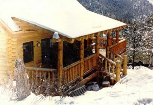 Log home porch in the snow