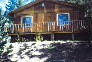 Remodel with log siding and Timberline log corners in the mountains